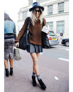 A baggy knit sweater plays off a rigid pleat mini skirt to make a must-have crisp-weather pair.    - ELLE.com