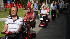 Senior citizens in Radin Mas SMC, Singapore, can hire scooters to get around. http://www.straitstimes.com/news/singapore/more-singapore-stories/story/electric-scooters-seniors-radin-mas-estate-20140629 Photo: Mark Cheong/The Straits Times