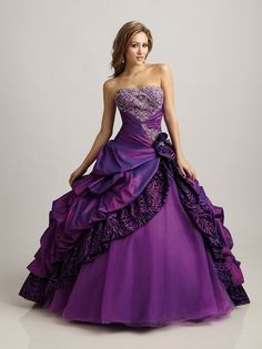 A fabulous full skirted purple ball gown from Allure Prom.