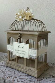 Adorable and a bit whimsical birdcage card holder. I like the lace against the wood. She lets you choose the ribbon color and flowers, too. (scroll down to #12 on the page). #MyOnlineWeddingHelp