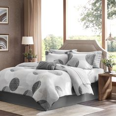 Glendale instantly updates the bedroom for a clean modern look with a circular print in different shades of grey covering this soft comforter. Several other bedding accessories are included, such as a decorative pillow, sham, bedskirt and sheet set.