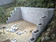 Tavalyi támfalépítés kibővítése, kerti lépcső építése, támfal és lépcső burkolása, térkövezés