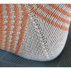 The Tom & Ethel Socks, named after the designer's parents, is a toe-up sock pattern in two sizes. The six