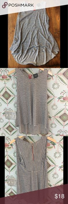 Super cute 🌟 Striped Long Tank Top Looks great with leggings and boots!! Can add a sweater and make it a fall shirt! Cute red zipper on the back, back is longer than front. Worn a few times but in great condition!! Size medium but is flowy, could fit large and could be an oversized shirt for smalls W5 Tops Tank Tops