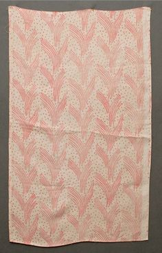 Carnac hand block printed furnishing linen by Phyllis Barron and Dorothy Larcher, the natural coloured ground with red stylised repeat design, 9 in; 24 cm repeat. 32 x 19 1/2 in w; 82 x 50 cm w