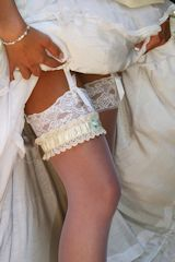 Dressing Bride with gorgeous lace top stockings and garter.