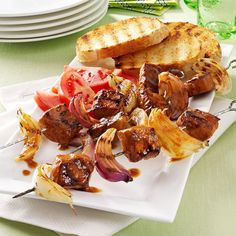 Pork and Onion Kabobs Recipe -A sweet and savory marinade brings out the best in pork, as these grilled kabobs prove. They're a super summer supper, easy to prepare and fun to serve to company. The pork is so tasty grilled with onion wedges. -Mary Lou Wayman, Salt Lake City, Utah