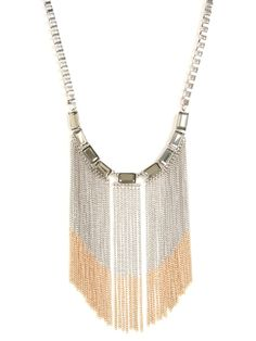 This gorgeous bib necklace packs a powerful style statement. Just check out those glam links, oversized faceted gems and, last but not least, that lush cascade of two-tone chain-link fringe.