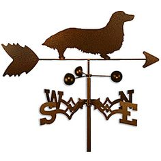 This weathervane is handmade of strong 14-gauge steel with a sealed ball bearing in the wind cups. The weathervane is coated with copper-colored powder coat paint, and features a Long Hair Dachshund dog.