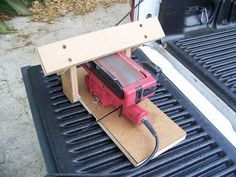 Belt Sander Sharpening Rest by Tool Using Animal -- Homemade rest intended to permit the utilization of a belt sander for sharpening tools. http://www.homemadetools.net/homemade-belt-sander-sharpening-rest