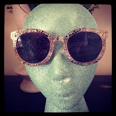Karen Walker Bunny engraved shades. My summer heart is set on these.