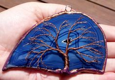 Copper Wire Tree Of Life Metal Wall Art Sculpture On A Dark Blue Agate Stone Crystal Suncatcher. $35.00, via Etsy.