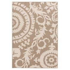 Anchor a vibrant room or add a touch of texture to your patio or living room with this eye-catching rug, featuring a floral medallion motif in a neutral pale...