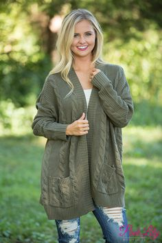 You have to grab this classic cardigan for your wardrobe - it's simply the best for fall! We adore the wonderfully soft knit fabric paired with a lovely shade of olive green - you can't go wrong with this one!