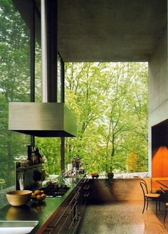 Stark interior with vast glazed windows that let nature in