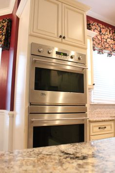 Fabuwood cabinetry, wellington door style, ivory glaze, double oven cabinet