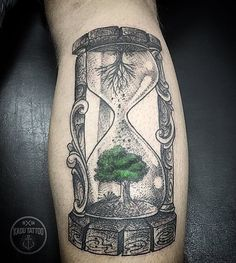 """Everything flows, everything changes. In the upper vessel at this tattoo we have dried tree without leaves in the lower vessel tree which is green and lively. Remember the sadness does not last forever, nothing lasts forever and no matter how hard is now, just close your eyes and think: """"This too shall pass""""."""