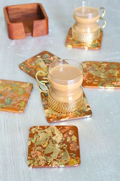Use variegated gold leaf flakes to create these easy DIY gold leaf coasters. Upcycle vintage teak coasters to create a beautiful hostess gift. Leaf Projects, Diy Craft Projects, Diy Crafts, Gold Leaf Art, Pretend Food, Gold Home Decor, Leaf Crafts, Diy Coasters, Coffee Staining