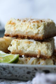 Coconut Lime Cheesecake Bars are creamy, tangy and DELICIOUS! The shortbread crust and the rich cream cheese pull everything together for the perfect potluck dessert!#cookiesandcups #recipe #baking #coconut #lime #cheesecake