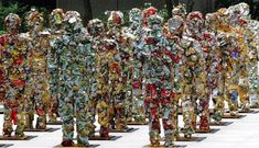 T^rash People.  One of the largest displays of recycled art in the world, Trash People was created by HA Schult and features 1000 trash men constructed out of aluminum cans, computer parts and plastic. It took over six months to complete and they have been displayed worldwide including the Egyptian Pyramids, China's Great Wall, La Grande Arche in Paris and New York.