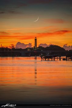 Beautiful crescent moon over the Jupiter Lighthouse in Palm Beach County, Florida along the waterway. HDR image created in Photoshop and Aurora HDR software.