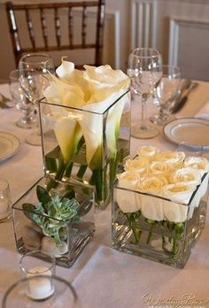 Simple & Elegant! We only have smaller square vases but you could add on to what we have to offer if you wanted this look!