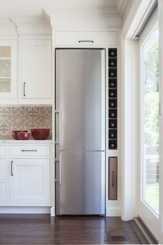 Built in wine rack next to fridge. We won't put in a skinny fridge, but this would still be great. Traditional Kitchen by Studio Dearborn