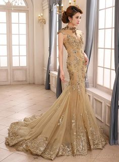 Possibly one of my favorite dresses, ever... mermaid dresses are gorgeous, and I love the train, the color, the neckline, the embellishments... xx