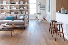 Fancy Home Living Room Flooring Design Ideas With Brown Wooden Floor And Combine With Grey Colored Sofas Also Oval Shape Wooden Coffee Table As Well As Living Room Floor  Plus Carpet Ideas For Living Room of Stunning Design Ideas Of Home Living Room Flooring from Interior Ideas