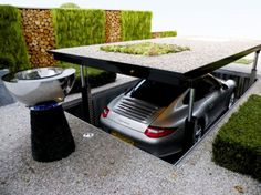 installation    Cardok: The Future of Garages    Cardok is an underground parking solution that doubles your parking space and provides greater security than a locked garage. It a is multi-platform lift that allows you to park your car underground. There is a video after the link.