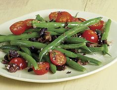Niçoise olives are a small French variety of black olive with a rich, briny flavor. If you can't find them, use Kalamata olives instead. Small Tomatoes, Cherry Tomatoes, Shallot Recipes, Olive Recipes, Roasted Vegetables, Veggies, Kalamata Olives, Vegetable Side Dishes, Fruit Recipes