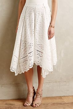 Cute shape on the skirt and love these types of patterns with materials...reminds me a bit of a doily...in a good way.