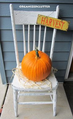 Easy Fall Decorating - Pumpkin on a Chippy White Chair