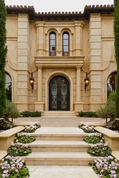 Exterior - grand entry - Tuscan style home in Beverly Hills | via Homes of the Rich #methodcandles #firstimpressions