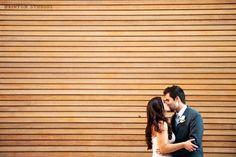 Cherry creek JW Marriott, Denver Colorado wedding, bride and groom kissing cool background