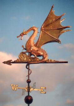 The Web Winged Dragon Weathervane is one of our favorite designs. It is handcrafted of copper with gold leaf detail. Personalized design available.