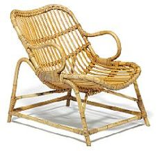 Flemming Lassen: Easy chair with frame of bamboo, seat and back with woven cane. Manufactured by E. V. A. Nissen & Co.