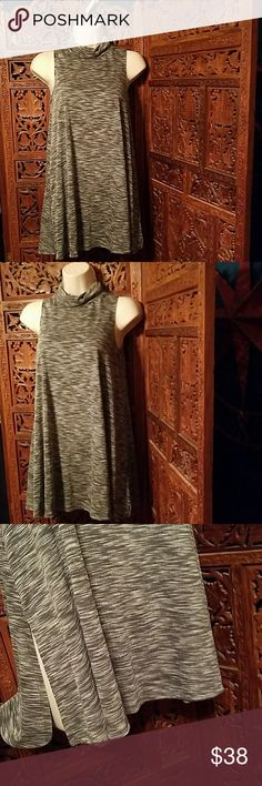 """NWOT Anthropologie postmark turtleneck tunic dress Anthropologie Postmark Sleeveless turtleneck tunic Heather gray Side slits Align flares out from bust Size small Oversized fit Measurements 29"""" long 14"""" bust laying flat 17"""" waist 21"""" his Excellent condition Anthropologie Dresses Mini"""