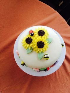Vanilla birthday sponge cake sunflower, lady bird and bee decorations