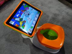 iPotty for iPad.  This is a real product being shown at the Consumer Electronics Show in Las Vegas this week.