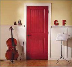 Red Interior Door With Pale Yellow/cream Walls.