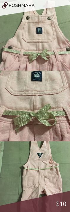Comfortable 🎀 Cute Overalls Baby B'Gosh 18 Months So cute and comfortable!  These light pink overalls from Baby B'Gosh feel like sweatpants but have a sweet metallic bow for added detail. Classic look!  Please message with any questions and check out other items in my closet!  Thank you! OshKosh B'gosh Bottoms Overalls