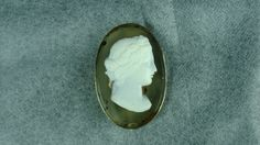 Gorgeous 18th century oval transparent agate background with high relief cameo of Bacchus pin brooch. It is on a sterling silver frame and measures 2 5/8 inches long ( 67 mm x 42 mm) x 1 5/8 inches wide, there is no mark found and in exceptional condition.