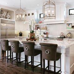 Classic barstools enhance this traditional kitchen - 18 Stylish Bar ...