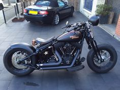 Harley Davidson Crossbones bobber Adjusted: Shadetree rear swing arm fender, HD solo seat, Collies license plate holder, tail light, turn signals, Wild Chubby handlebar, PM grips, RSD air cleaner, V&H exhaust, battery cover, mirror, powder coating engine covers, Japanees army pouch