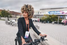 Our stand host Tatiana takes the Stromer ST2 e-bike for a test drive at Mobile World Congress.