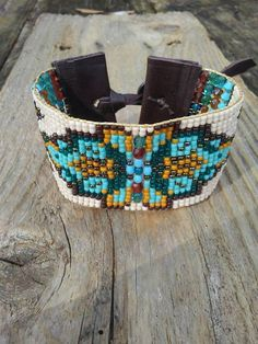 Bead Loom bracelets, bead woven bracelet, boho bracelet, Southwest bracelet, Native American inspired bracelet, ooak. This one of a kind bracelet meticulously woven using Czech glass, Swarovski crystals, and Japanese seed beads. It measures one and a half inches wide and fits a 7 in