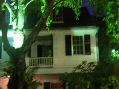 This photo was taken at the Audubon House and Gardens in Key West around 10:00pm. Notice the figure standing on the porch. Could this be the wife of Captain Geiger, the ship Captain who built the home, or Captain Geiger himself? Several of their 9 children died in the home of yellow fever.
