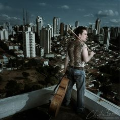 Mauro Lombardi Brucoli. Principal cellist with the Orquestra Synfonica Municipal de Sao Paulo. One of the best cellists in Brazil and one of the nicest section principals you could ever have (despite the scary tattoos!). We photographed him on top of an apartment block in Sao Paulo.  #tattoo #dragon #tiger #cello #cellist #classicalmusic