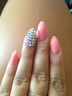pastel pink + spikes stiletto nails
